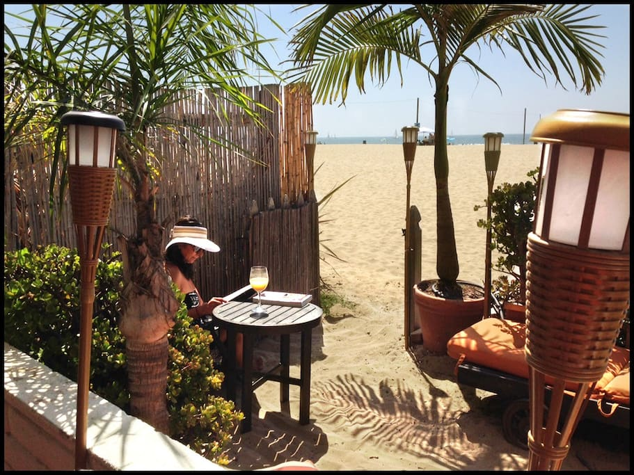 Downstairs, you can step onto the sand right from our sand patio.