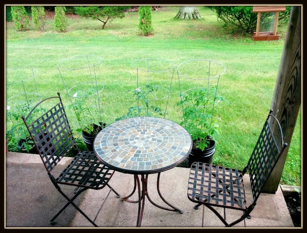 A quiet back porch where you can enjoy a nice breeze, or a cup of tea/coffee in the morning.