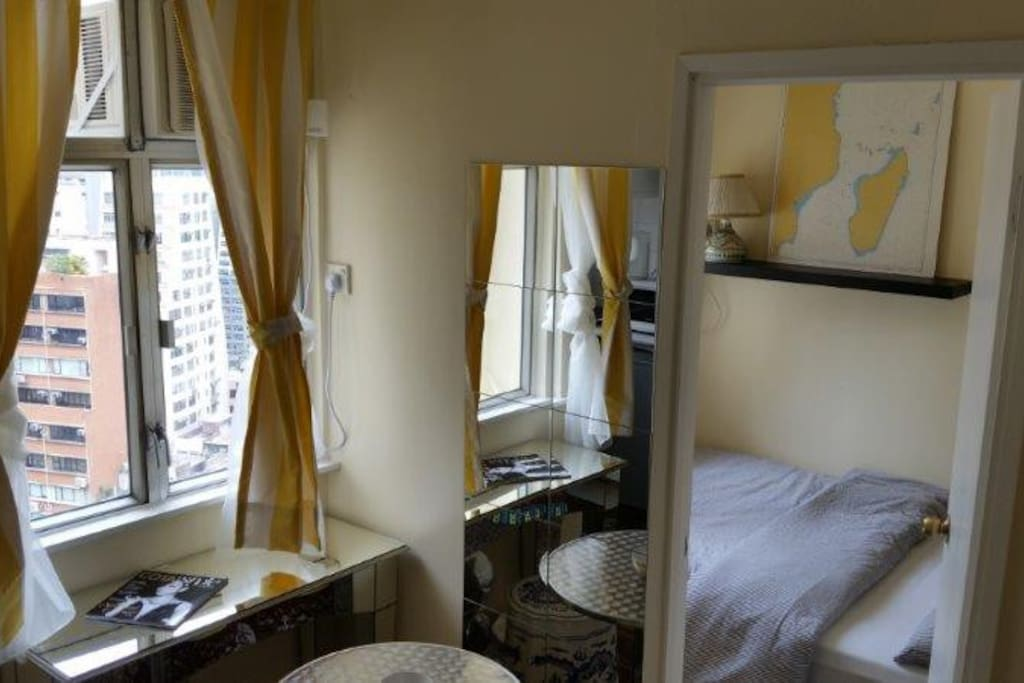 One of the two bedrooms, off the dining area, with its view of central