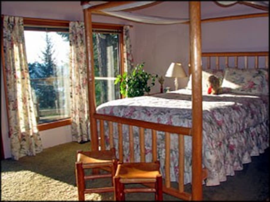 Queen Bedroom with private bathroom suite, with view and door to the deck & hot tub.