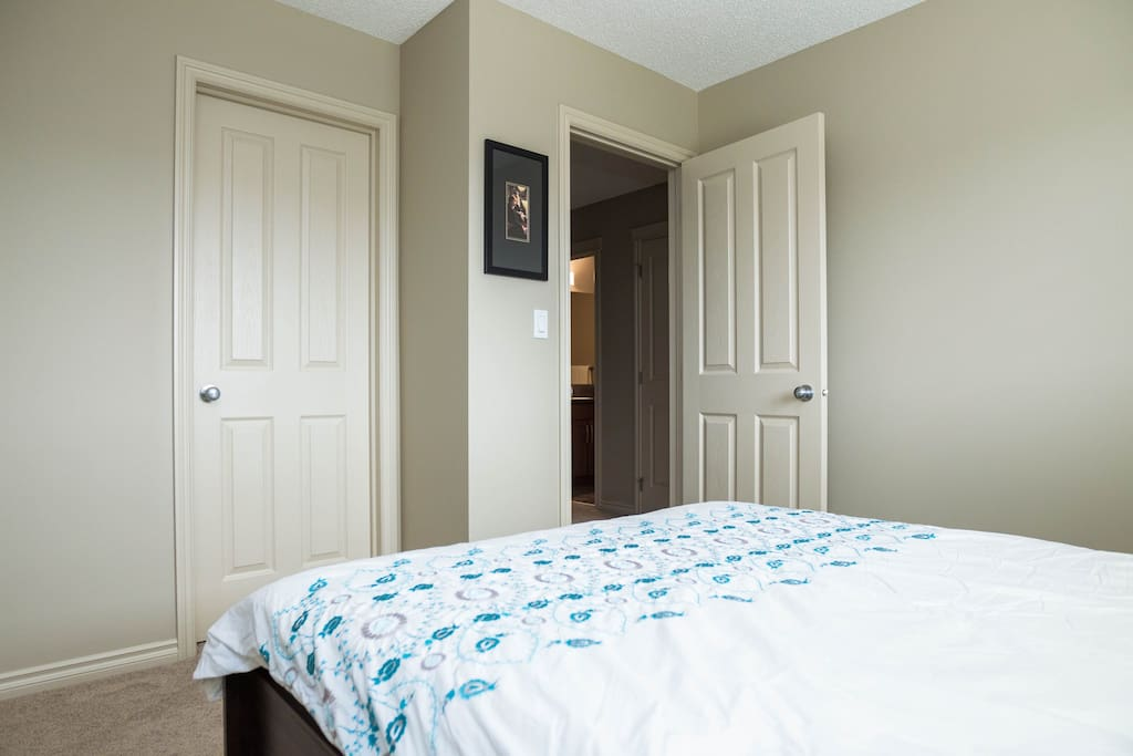 Bedroom has a large window, two bedside tables, lamp, and walk in closet. Linens provided.