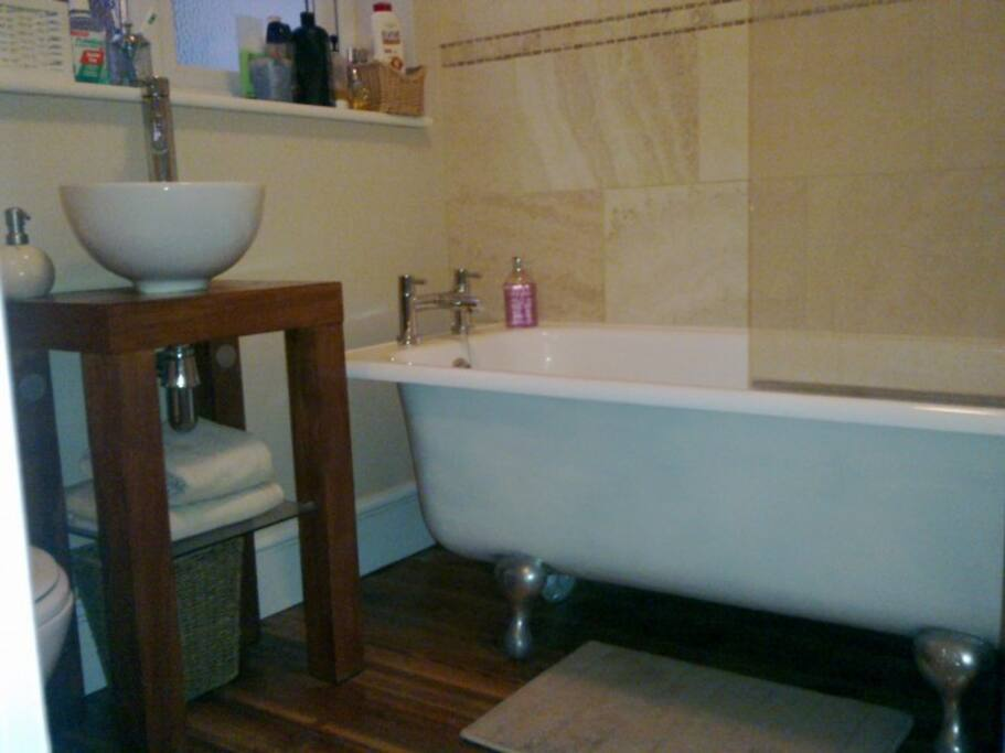 freestanding bath, fluffy towels and steamy hot water
