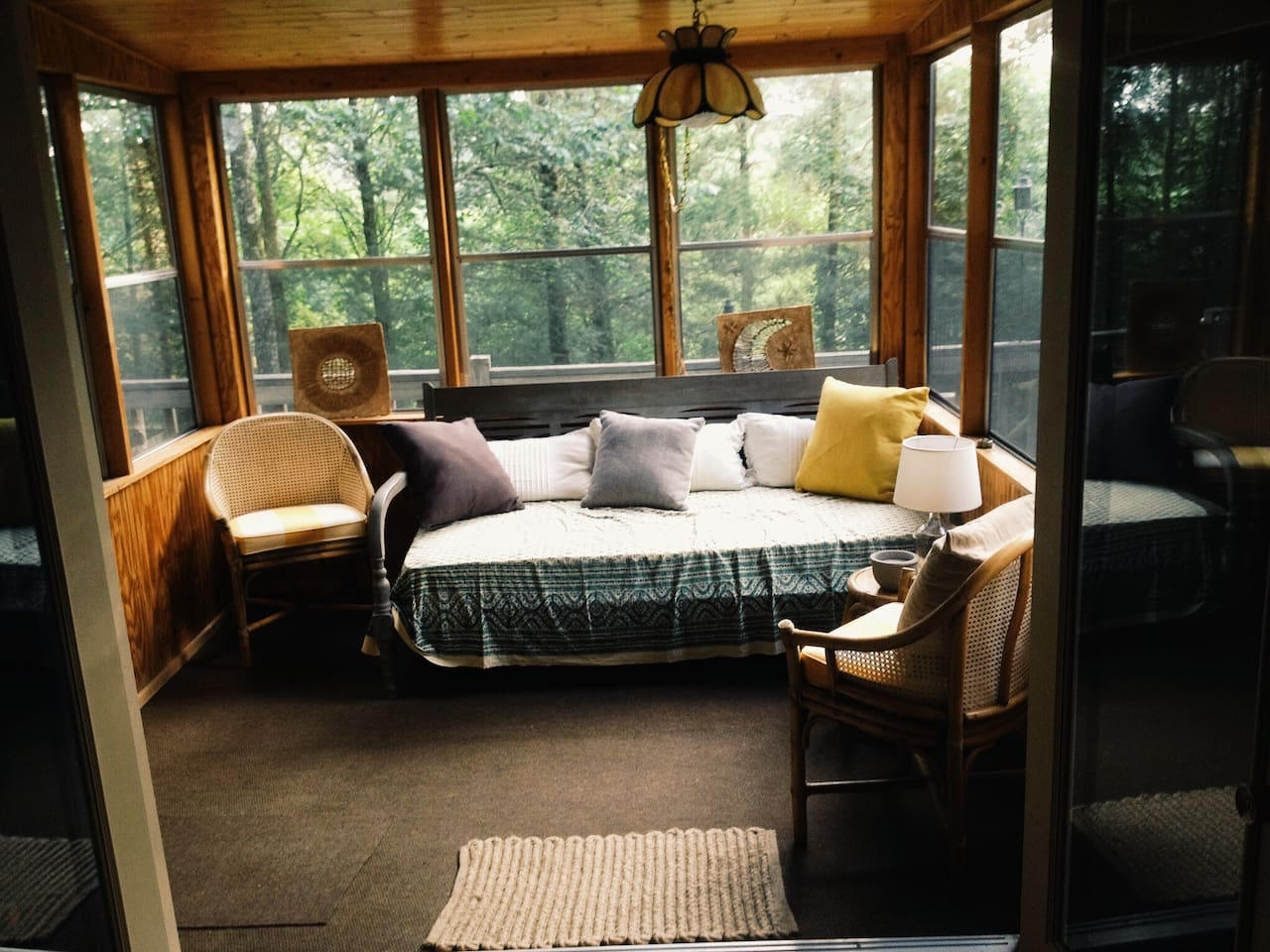 Glassed in sunporch can sleep one person on the day bed. Sun porch leads to two level deck with view of the river. Gas grill on deck.