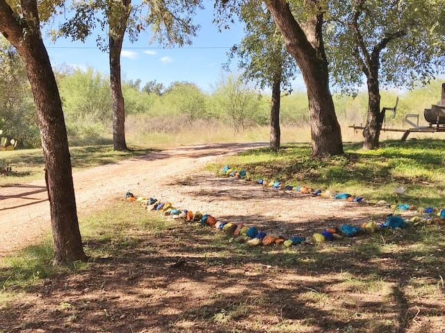 Look for property number on the tree, then turn in to your left and into your colored rock lined parking place.