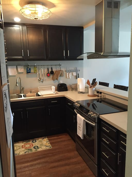 Fully stocked and remodeled kitchen to prepare meals and save money if you want.