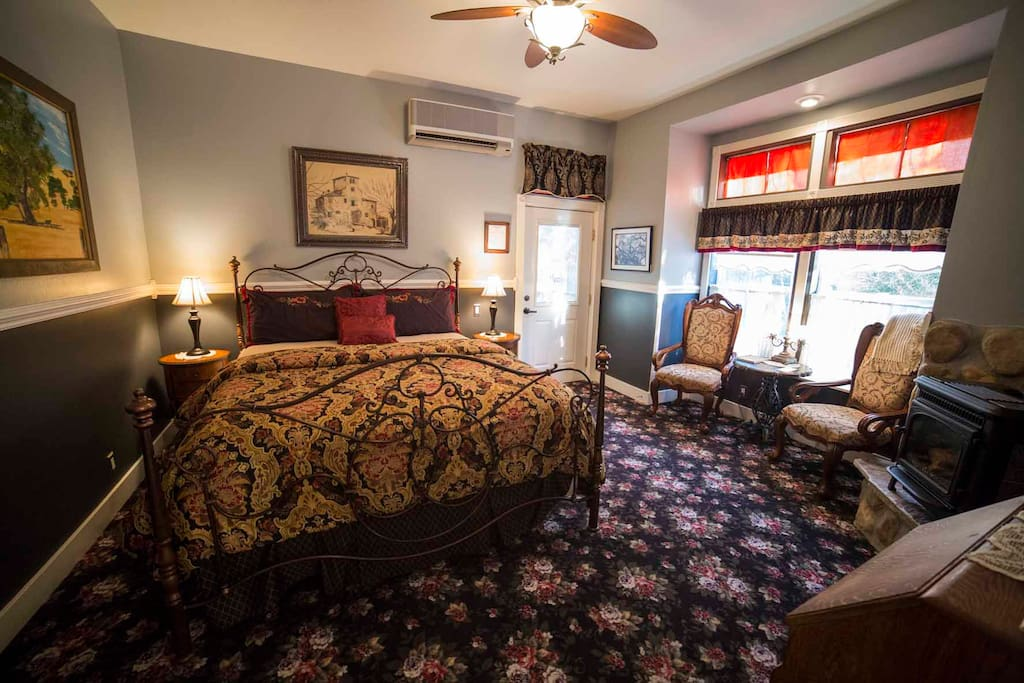 Beckmen features a California King size bed, gas fired wood stove, and sitting area along with a private entrance