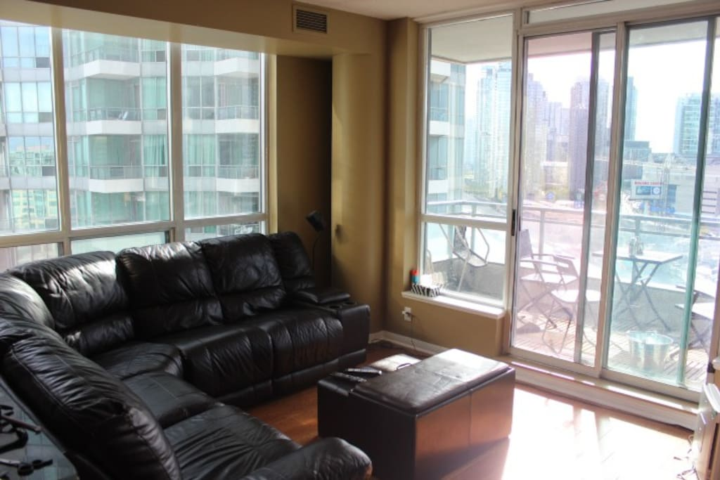living area with plush leather couch and big screen tv