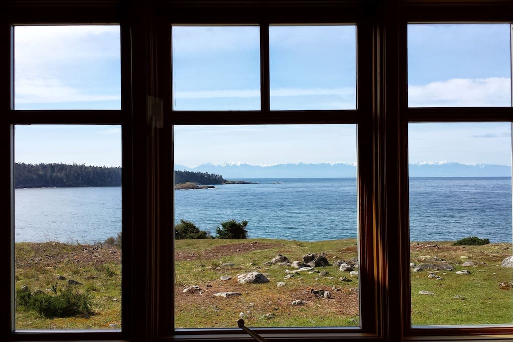 View of Iceberg Point, the Salish Sea (Strait of Juan de Fuca), and the Olympic Mountains from the kitchen window.