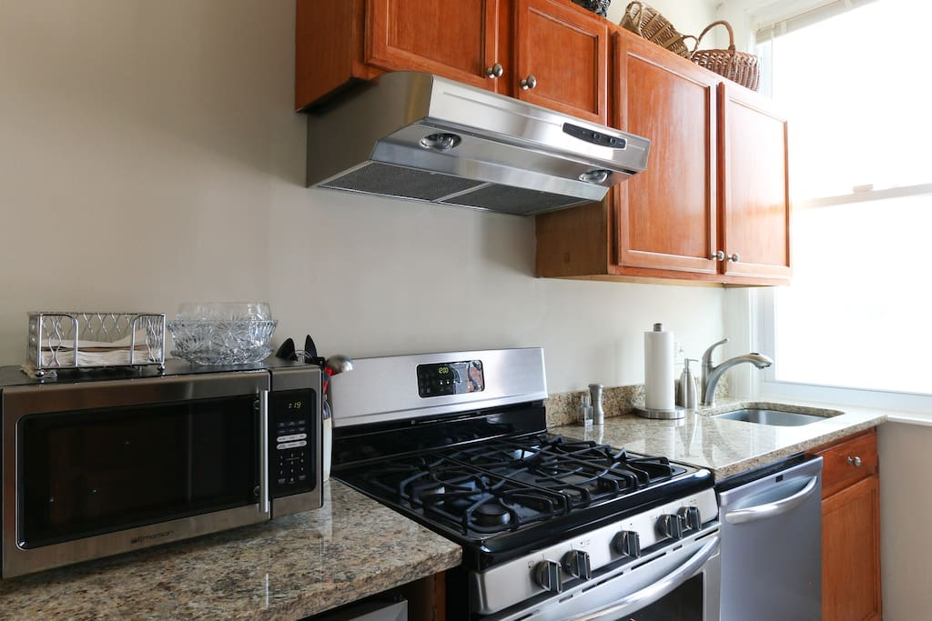 Kitchen with gas stove, microwave and dish washer