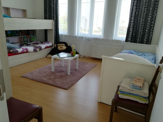Large private bedroom in our house near Ghent