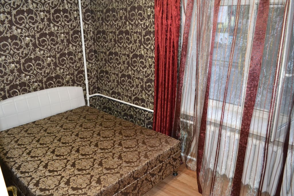 There is air conditioning, dark curtains. Orthopedic mattress.Bedroom