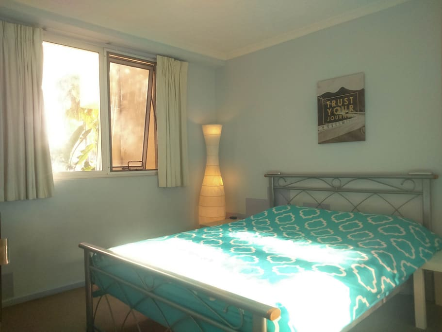 The room is furnished with a queen, side tables and a small shelf for your convenience. Also you will have a wardrobe to store your luggage and belongings.