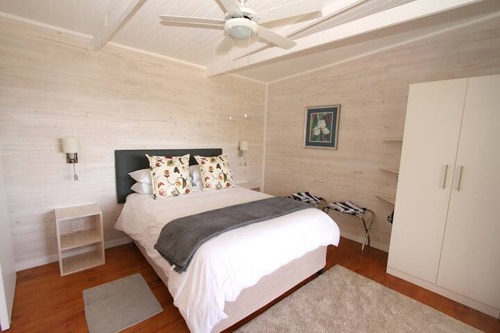 Main bedroom with queen-sized extra length bed