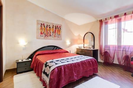 BiancaMilù stanza beige - Isola Sacra