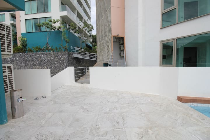 Walkway to Building A from swimming pool area after exiting from lift.