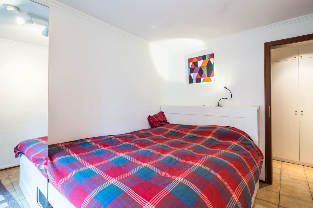 The bedroom with a double bed and ample storage