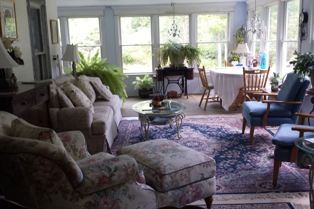 Enjoy our southern exposure sunroom with its comfy chairs and enough space for several to sit and visit.