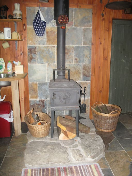 The Bothy is heated by a wood burning stove that stands on a little plinth and keeps the place toasty