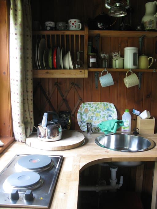 There are two rings, a sink, kettle and toaster for you to make your own food -