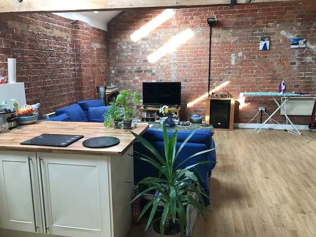 Private penthouse room in the historic Cotton Mill