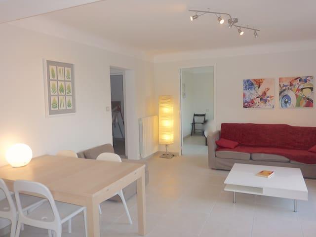 Open plan living room with indoor dining area. ground floor