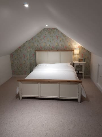 Large, sunny converted attic room in family home