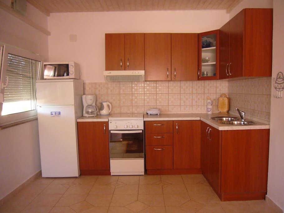 Kitchen, on the left side of front door