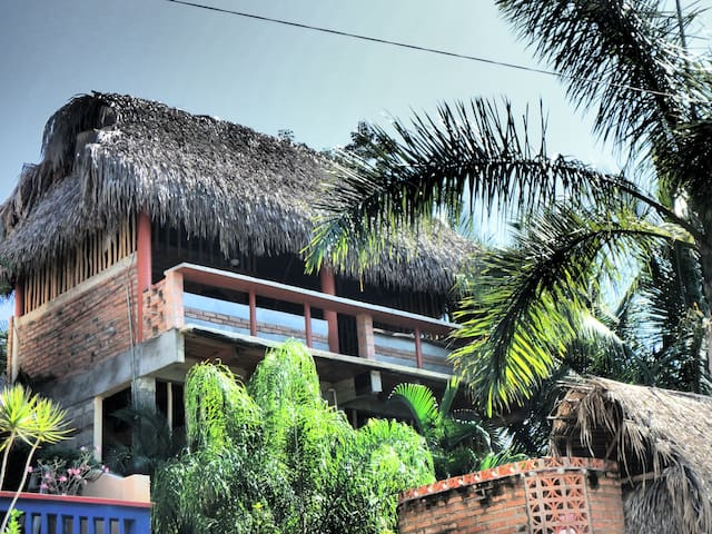 the Treehouse sits high above the property, thatched roof, and open air keeps it nice and cool.