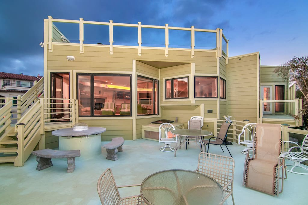 This property seamlessly combines indoor/outdoor living space with multiple patios.