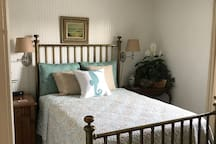 Second floor bedroom with double brass bed