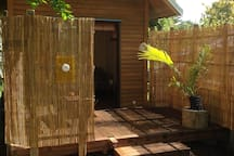 Sleepout with macrocarpa timber,mezzanine and deck