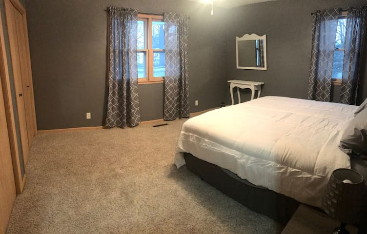 Main floor - master bedroom with king bed