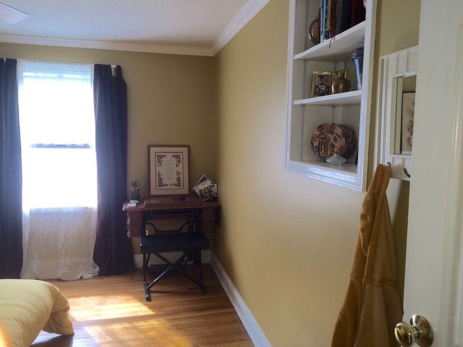Second floor, single family home.  Note small desk and wall shelf that can be used for clothing storage.