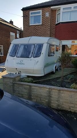 Clean, tidy, bright 2 birth caravan with awning.
