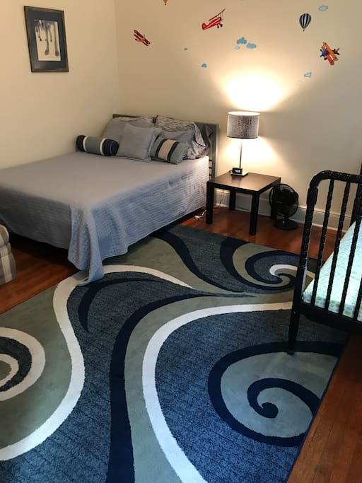 Your bedroom has a full-size bed, floor cushion mattress, love seat, nightstand, AC, and two bright windows.