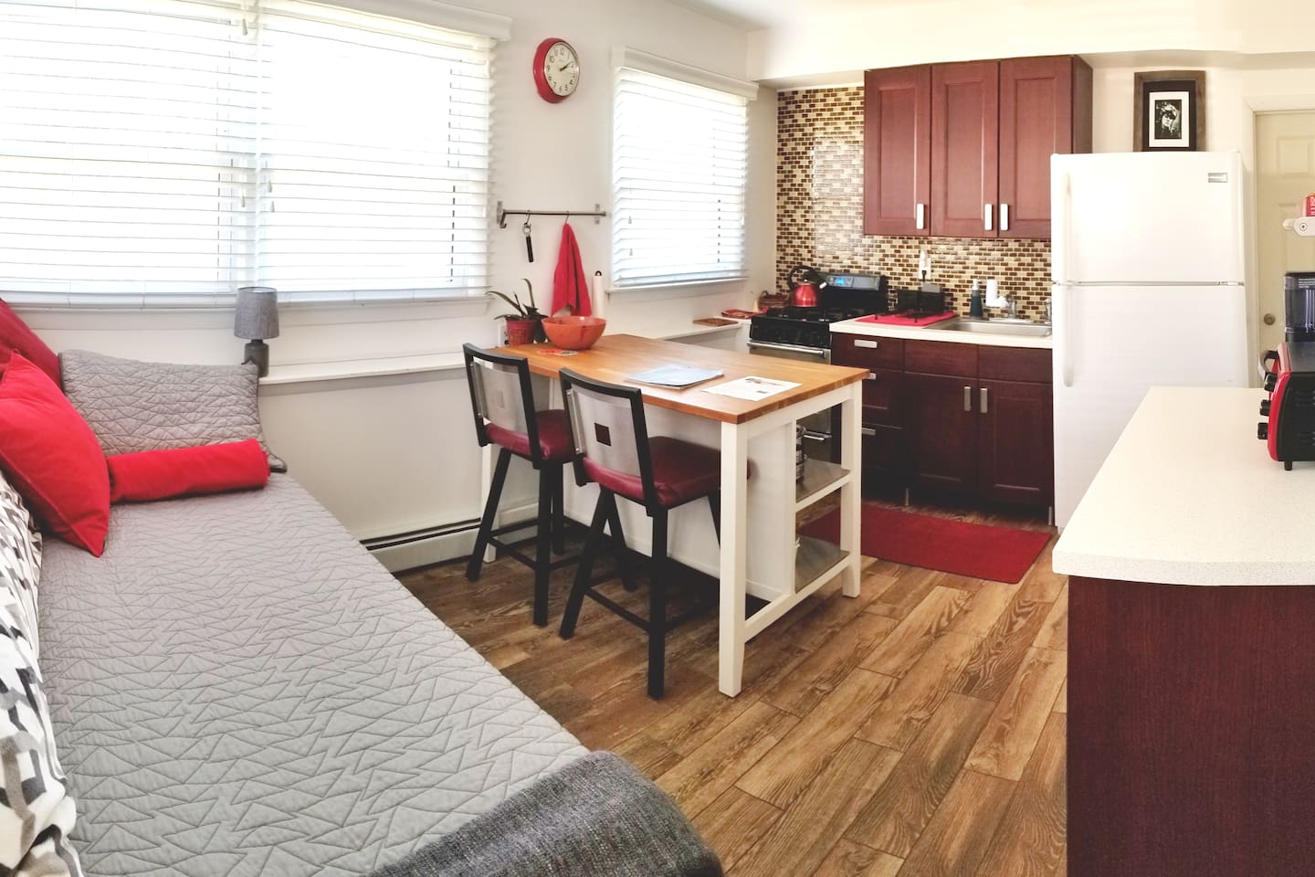 A panoramic view of the kitchen and daybed. Private entrance also located in the room but not photographed. Daybed can be used for 2nd guest if needed, only 2 people are permitted to stay in apt..