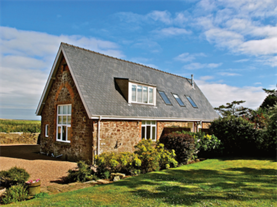 The detached property sits in stunning walled gardens