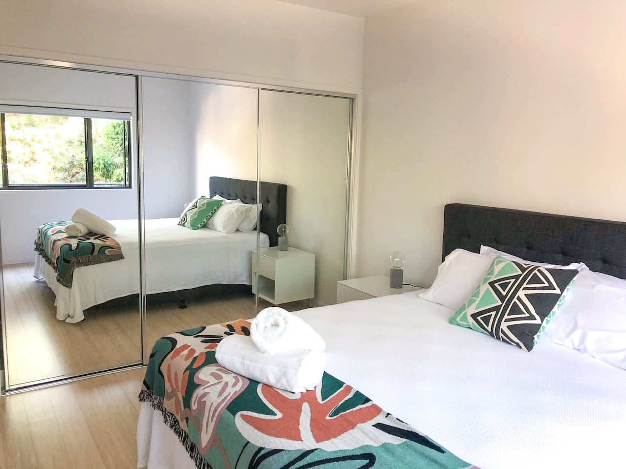Large bedroom with generous built-in wardrobes.