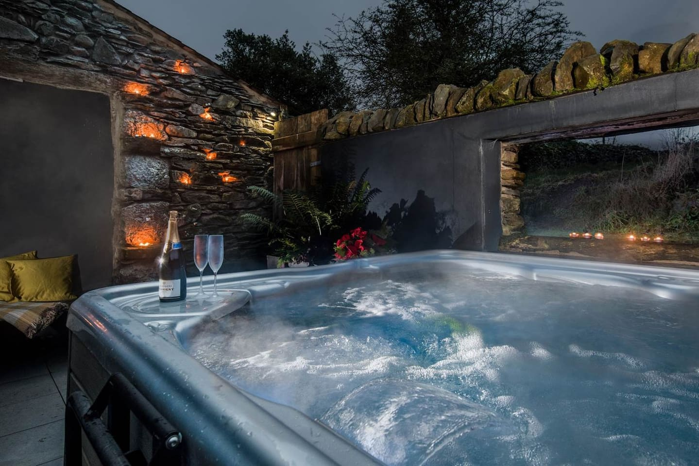 Hot tub in sunken walled courtyard with window view over our field