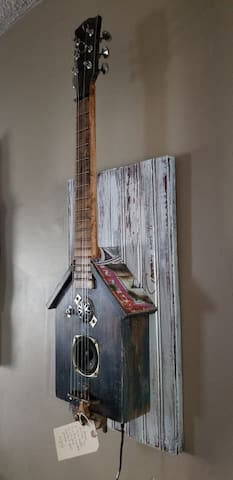 Listen to your playlist through this bluetooth birdhouse guitar.