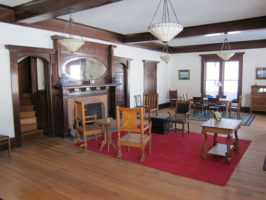 You enter in the great room with original woodwork.