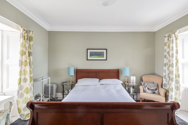 The large bed in the Harris family room area.