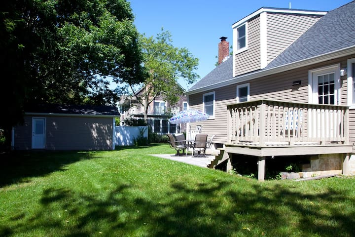 Back garden with deck, patio and barbecue