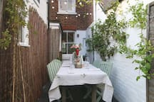 Side return with outside dining area with lights for evening dining