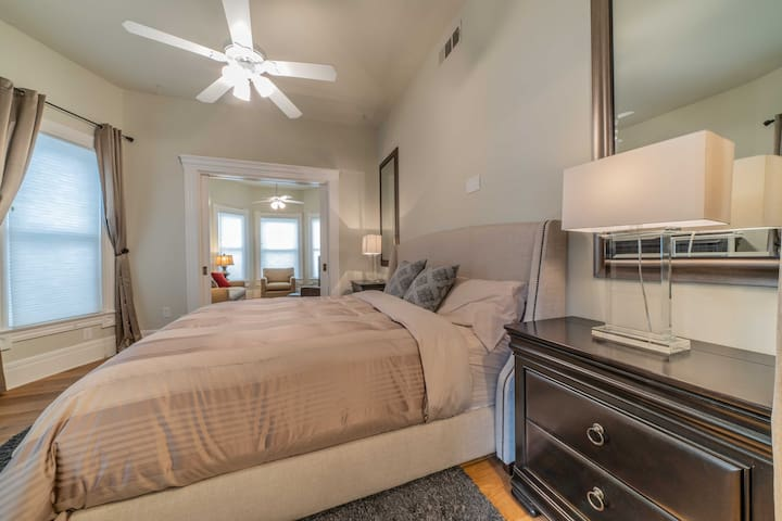 1st Level King Bedroom - Room is separated by double doors that lead to living room and separated by curtains that lead to kitchen.