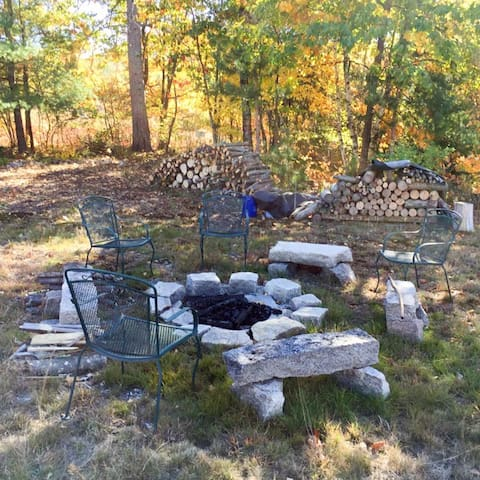 Camp-fire out back. Historic Cemetery is a walk through the back-yard.
