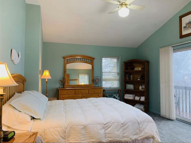 Masterbedroom Oasis! Complete with Private Balcony! You will LOVE the vaulted ceilings...makes the room look so GRAND!