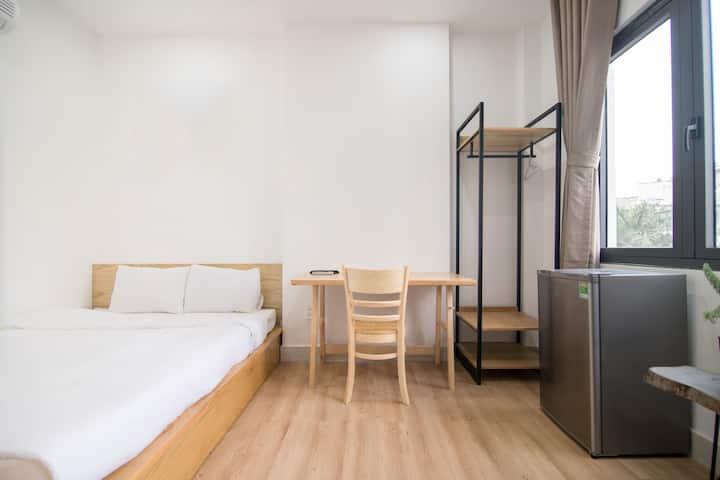 Sunny basic room near airport Saigon Dwelling