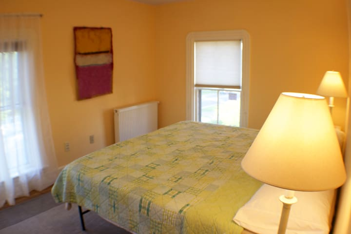 Yellow Room - King Bed (Casper - Firm) - Street Facing - Windows Face East and South - Open Clothing Storage & Hanging Rack