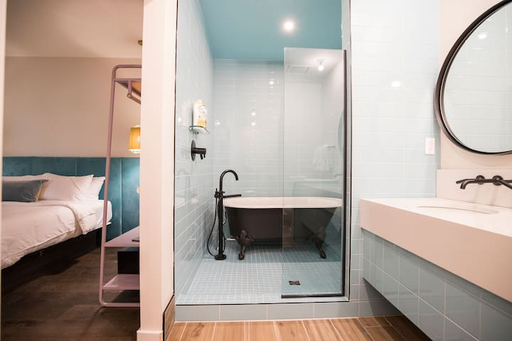 This bathroom serves as a dual purpose shower and bathtub for all of your hygiene preferences!